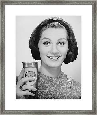 Woman Holding Up Can Of Beer Framed Print by George Marks