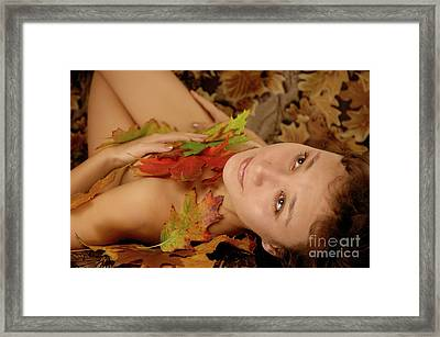 Woman In Fallen Leaves Framed Print by Oleksiy Maksymenko