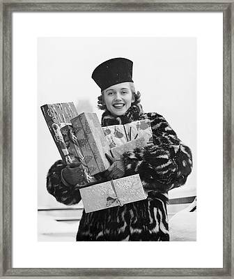 Woman In Fur Coat Holding Christmas Gifts Framed Print by George Marks