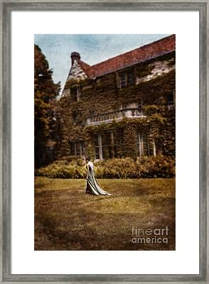 Woman In Gown Walking Outside A Mansion Framed Print