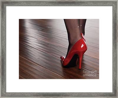 Woman In Red High Heels Walking On Hardwood Floor Framed Print