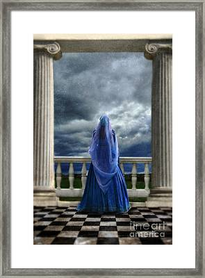 Woman In Renaissance Clothing On Balcony Framed Print by Jill Battaglia