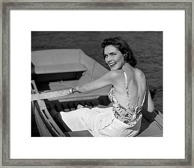 Woman In Row Boat Framed Print by George Marks