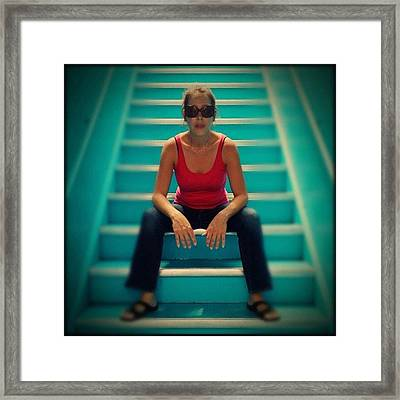 Woman In Stairs Framed Print