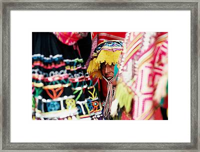 Woman In Traditional Hat Looking Through Textiles And Fabric Of Stall, Peru, South America Framed Print by Richard I'Anson