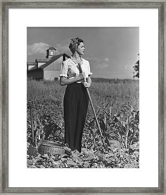 Woman In Vegetable Garden Framed Print by George Marks