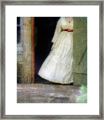Woman In Vintage Victorian Era Dress In Doorway Framed Print by Jill Battaglia
