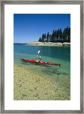 Woman Kayaking, Penobscot Bay, Maine Framed Print by Skip Brown
