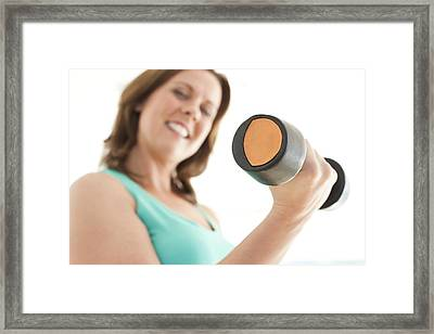 Woman Lifting Weights Framed Print by Ian Hooton