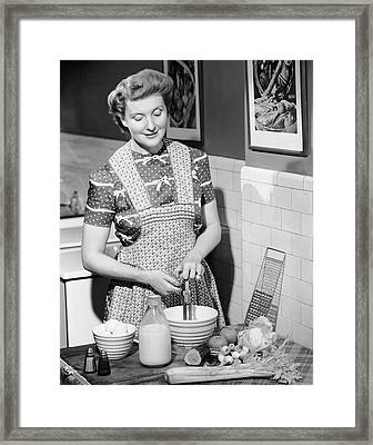 Woman Mixing Ingredients In Bowl Framed Print by George Marks