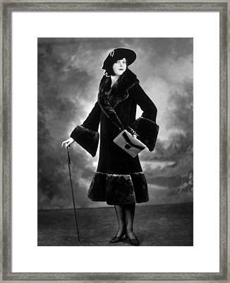 Woman Modeling A Lorna Dunn Fur Coat Framed Print by Everett