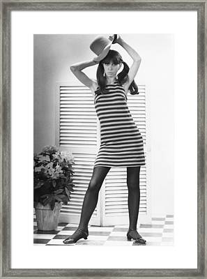 Woman Modeling Fashion Framed Print by George Marks