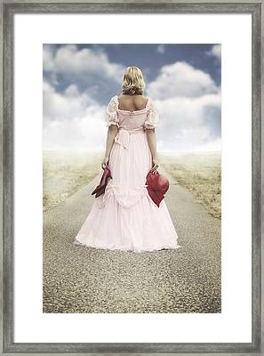 Woman On A Street Framed Print