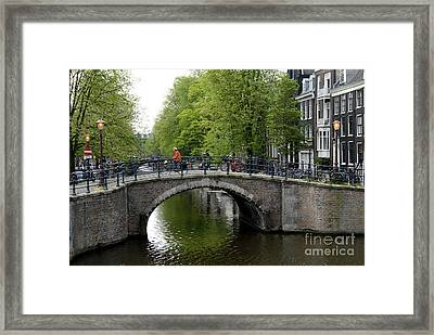 Woman On Bike Framed Print by Ed Rooney