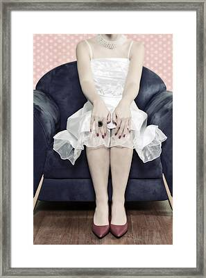 Woman On Chair Framed Print