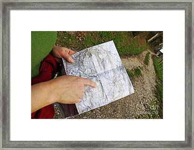 Woman On Country Road Pointing Map Framed Print