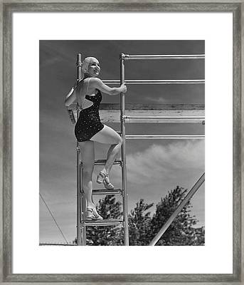 Woman On Diving Board Framed Print by George Marks