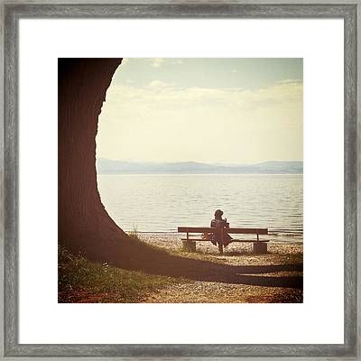 Woman On The Shore Of A Lake Framed Print
