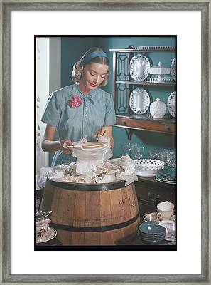 Woman Packs, Unpacks A Barrel With Dishes Framed Print by Archive Holdings Inc.