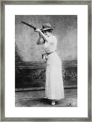 Woman Posed With Shotgun Framed Print by Everett