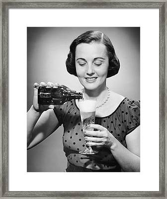 Woman Pouring Alcoholic Beverage Framed Print by George Marks