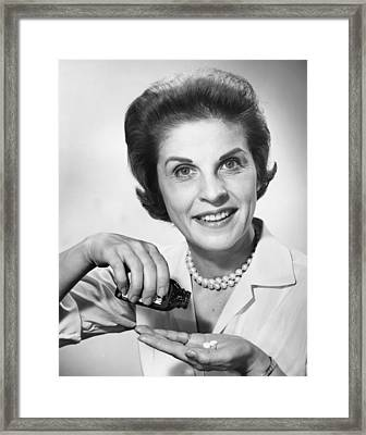 Woman Pouring Pills From Bottle Framed Print by George Marks