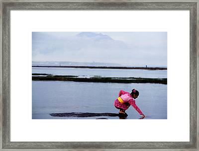Woman Reaching Into Water With Gunug Agung In Background Framed Print by Gregory Adams