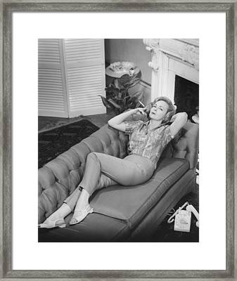 Woman Relaxing On Sofa, (b&w), Elevated View Framed Print by George Marks