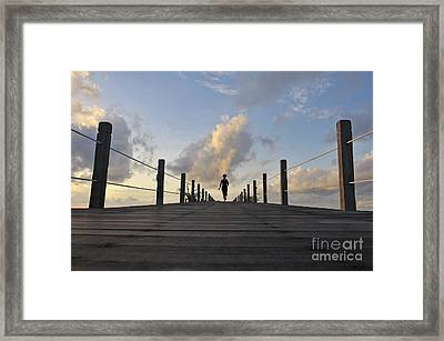 Woman Running On Wooden Jetty At Sunrise Framed Print by Sami Sarkis