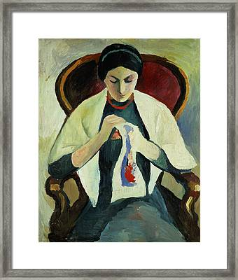 Woman Sewing Framed Print