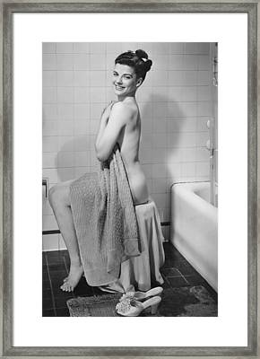 Woman Sitting In Bathroom, Covering Herself With Towel, (b&w), Portrait Framed Print
