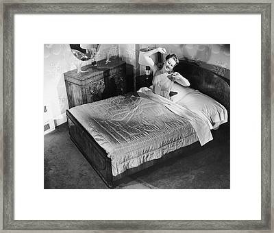 Woman Sitting In Bed Stretching Framed Print by George Marks
