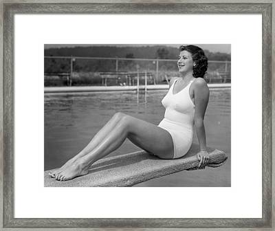Woman Sitting On Divingboard Framed Print by George Marks