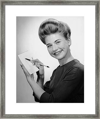 Woman Smiling W/pen & Pad Framed Print by George Marks