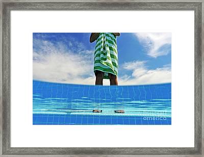 Woman Standing On Swimming Pool Ledge Framed Print by Sami Sarkis