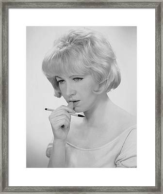 Woman Thinking What To Write Framed Print by George Marks