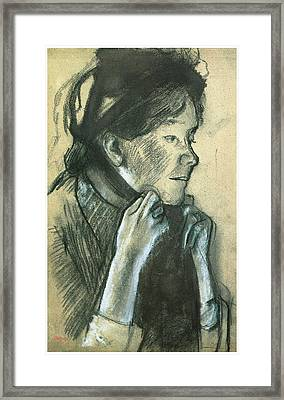 Woman Tying The Ribbons Of Her Hat Framed Print by Edgar Degas