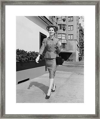 Woman Walking Down Sidewalk Framed Print by George Marks