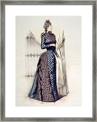 Woman Wearing A Bustle Dress Framed Print by Everett