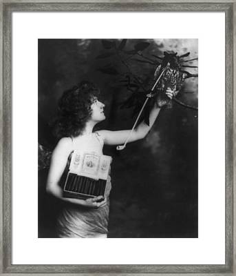 Woman Wearing A Winged Costume Framed Print by Everett