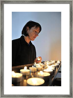 Woman With Candles In Church Framed Print