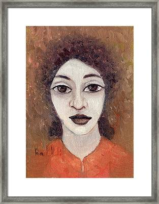 Woman With Large Dark Brown Eyes And Hair Orange Shirt Dark Eyebrows  Framed Print by Rachel Hershkovitz