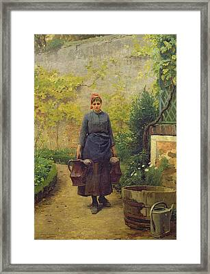 Woman With Watering Cans Framed Print