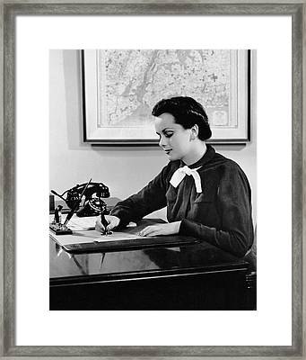 Woman Writing At Desk Framed Print by George Marks