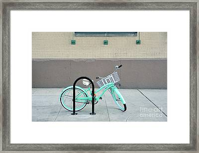 Woman's Bicycle  Framed Print by Ed Rooney