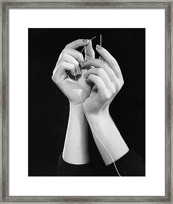 Woman's Hands Threading Needle Framed Print by George Marks