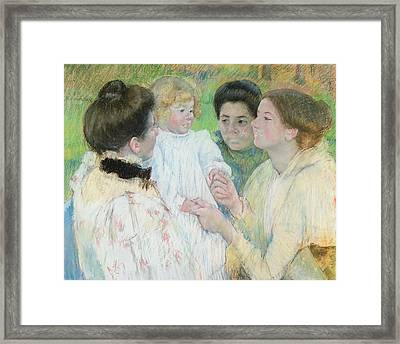 Women Admiring A Child Framed Print by Mary Stevenson Cassatt