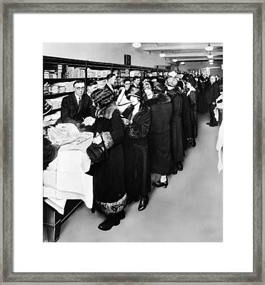 Women Eagerly Shop Across The Counter Framed Print by Everett