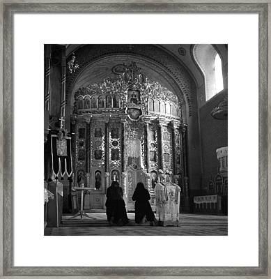 Women Praying In Church Framed Print