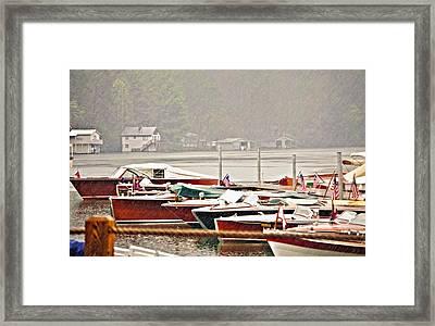 Wood Boats In The Rain Framed Print by Susan Leggett
